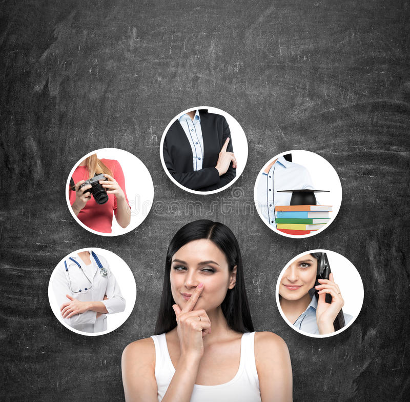 A portrait of a young artful brunette lady who is trying to chose the right career path. A range of images with different careers. Are drawn on the black stock photography