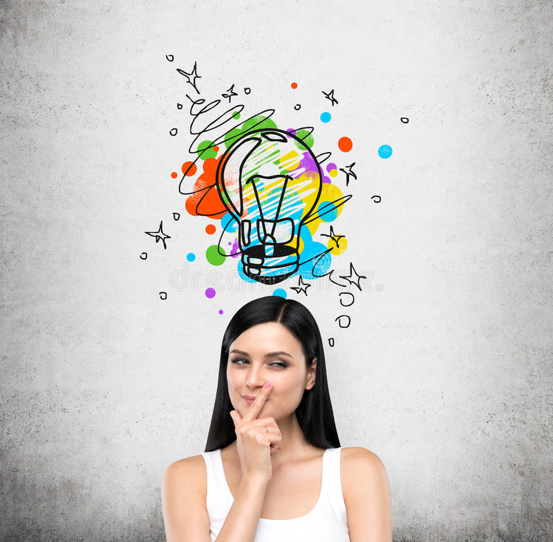 A portrait of a young artful brunette lady who is trying to create a new idea for some business project or case study. A colourful royalty free stock images