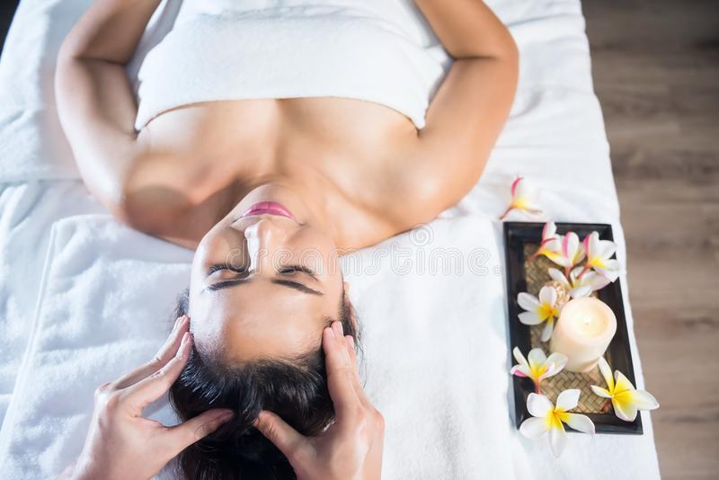Oil head spa massage to woman royalty free stock images