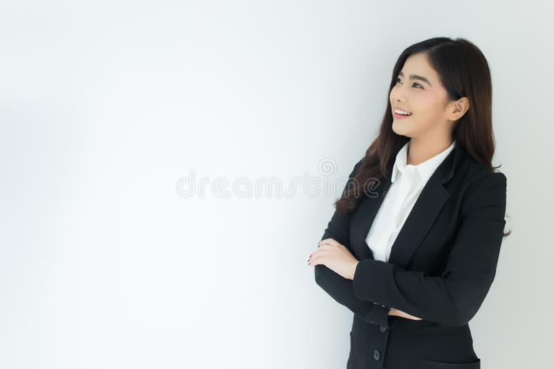 Portrait of young asian business woman crossed her arms over white background. stock photos