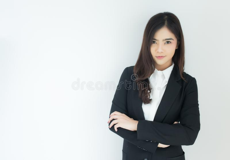 Portrait of young asian business woman looking at camera over white background. royalty free stock images
