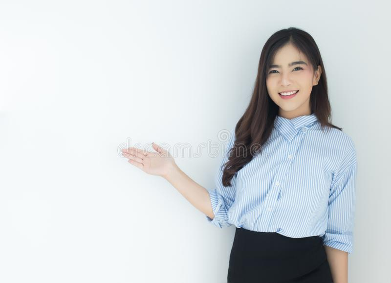 Portrait of young asian business woman presenting over white background. royalty free stock photos