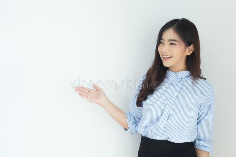 Portrait of young asian business woman presenting over white background. royalty free stock images