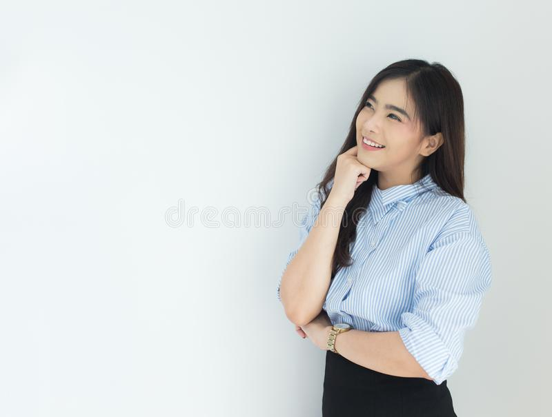 Portrait of young asian business woman thinking over white background stock photo