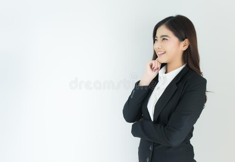 Portrait of young asian business woman thinking over white background. royalty free stock images