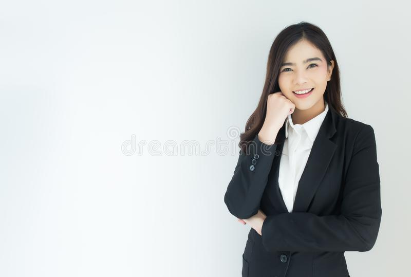 Portrait of young asian business woman thinking over white background. royalty free stock image