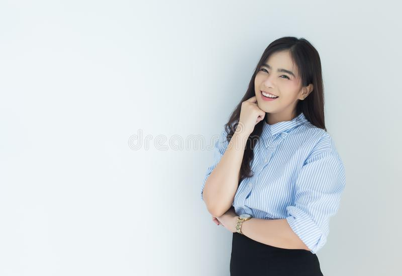 Portrait of young asian business woman thinking over white background. stock photos