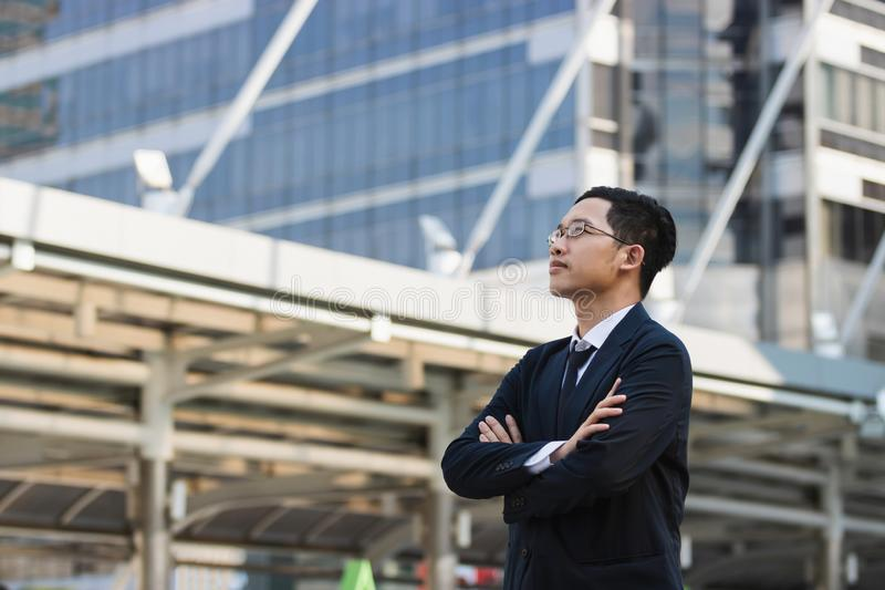 Portrait young Asian executive businessman in suit looking at far away outdoors. Business vision concept royalty free stock photo