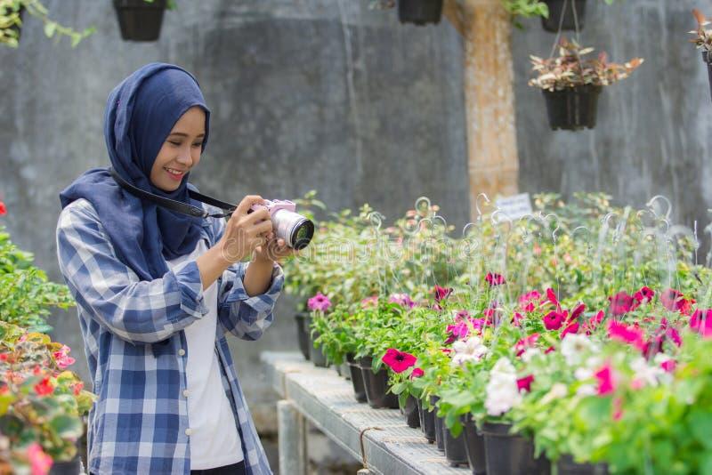 Florist with camera stock photos