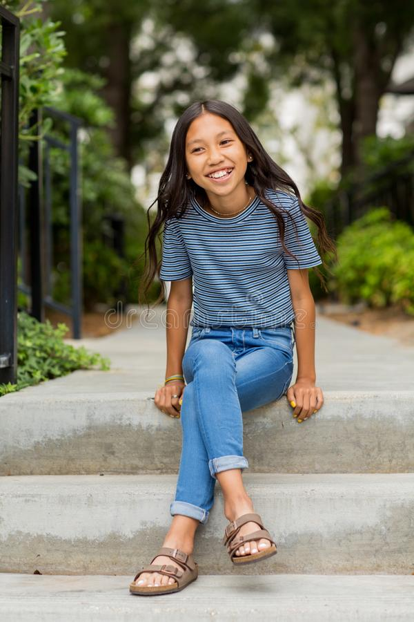 Portrait of a young Asian girl smiling outside. royalty free stock photo
