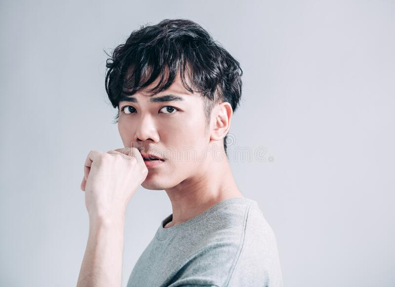 Portrait of young  asian handsome man isolated on gray background stock images