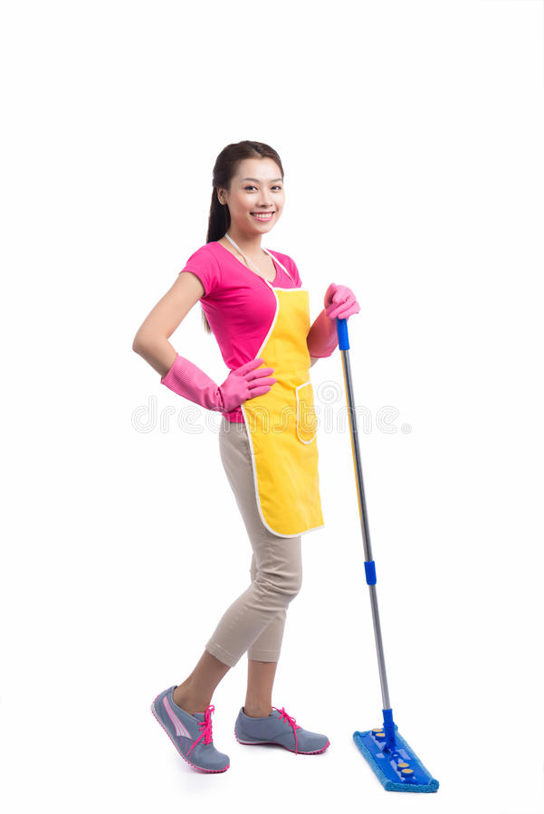 Portrait Of Young Asian housewife Cleaning Floor With Mop in full length royalty free stock image