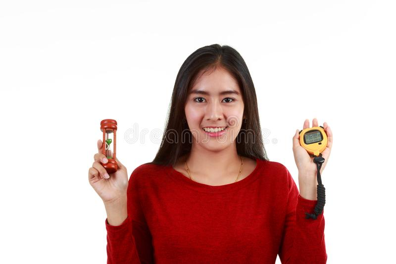 Portrait of Young Asian lady checking Timer by hourglass or stop watch stock images