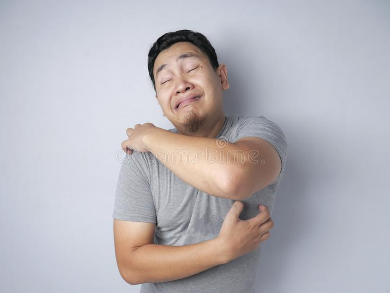 Man Feel Itchy Scratch his Body royalty free stock photography