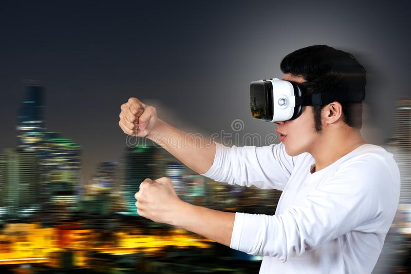 Man playing virtual car racing video game royalty free stock images
