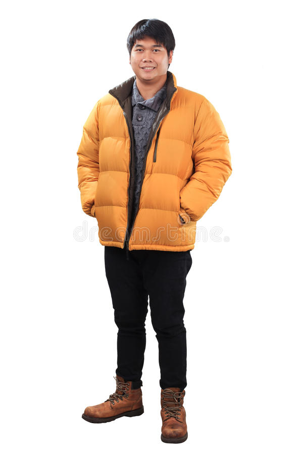 portrait of young asian man wearing yellow winter jacket and black jeans leather shoes standing with smiling face isolated white royalty free stock photo