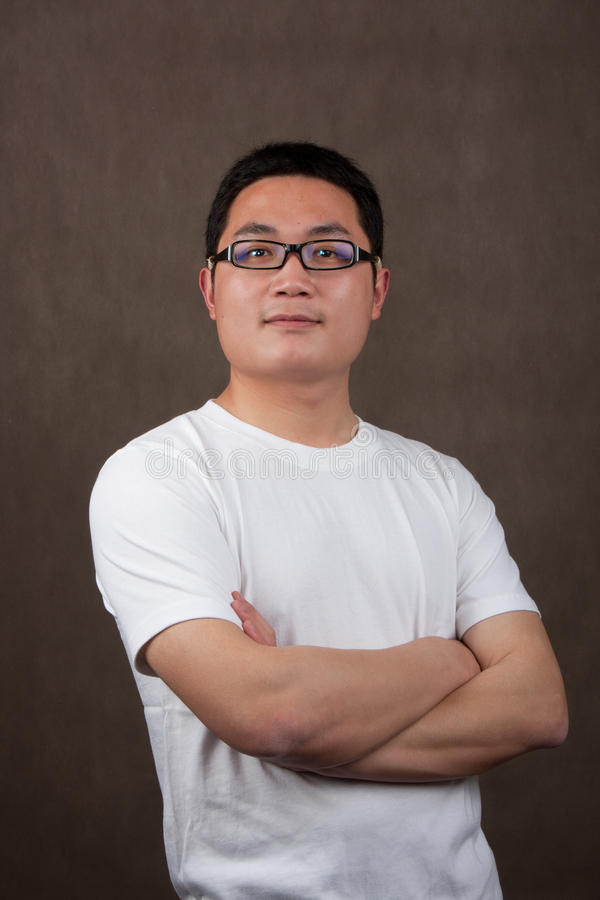 Download Portrait Of A Young Asian Man In A White T-shirt Royalty Free Stock Images - Image: 19683919