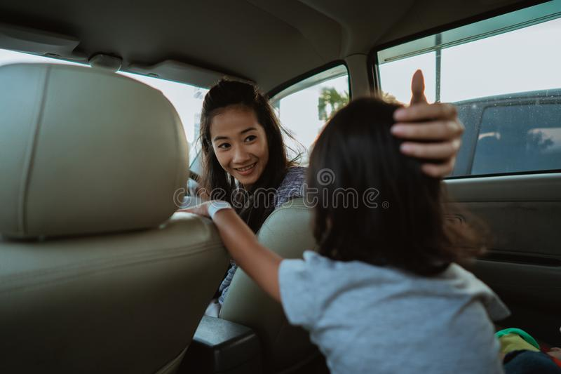 Portrait of young asian mother driving a car stock photo