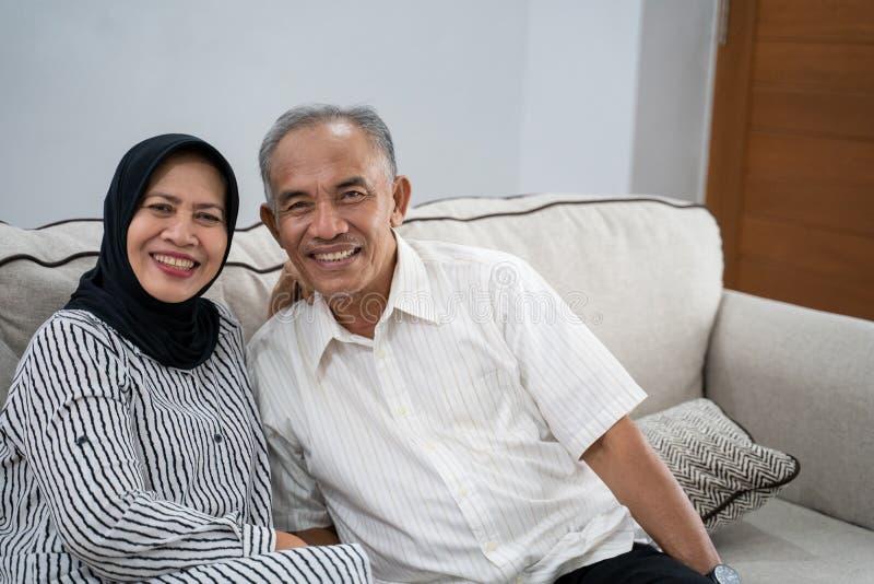 Asian muslim eldery couple together stock photos