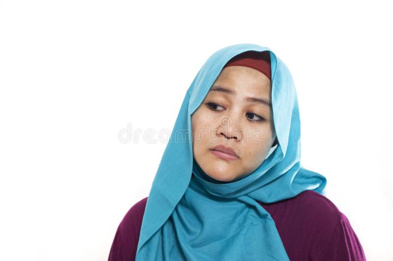 Asian Woman with Tired Sluggish Gesture. Portrait of young Asian muslim woman showing tired diizzy sluggish gesture, isolated on white stock image