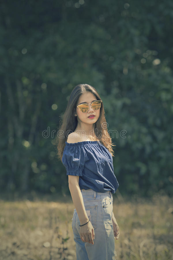 Portrait of young asian woman outdoor cinema color process style royalty free stock images