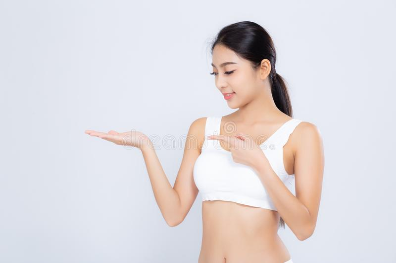 Portrait young asian woman smiling beautiful body diet with fit presenting something copy space on the hand isolated. On white background, model girl weight stock photo