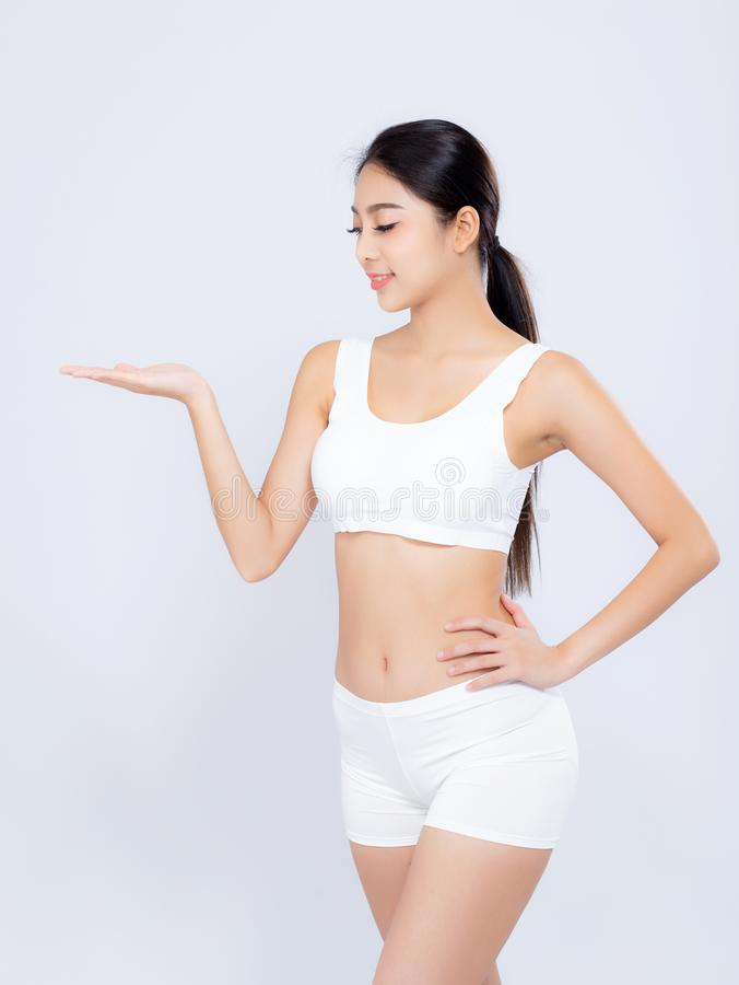 Portrait young asian woman smiling beautiful body diet with fit presenting something empty copy space on the hand isolated. On white background, model girl royalty free stock photography