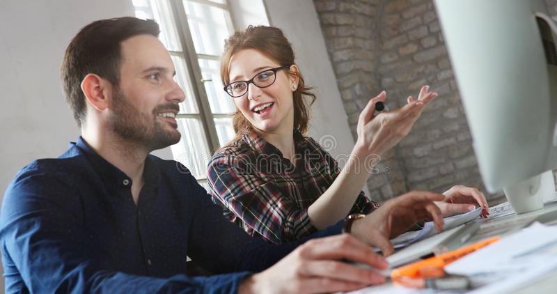 Portrait of young designers working on computer royalty free stock photography