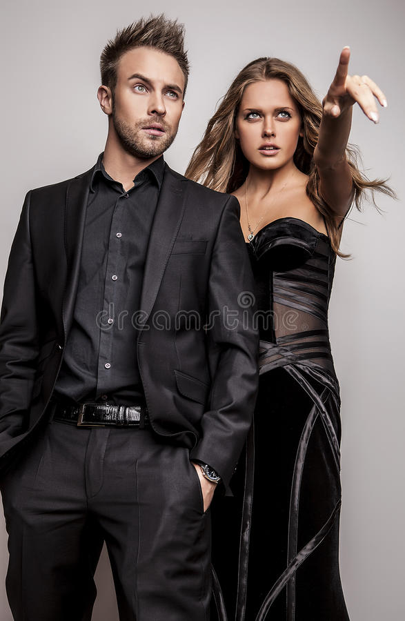 Download Portrait Of Young Attractive Couple Posing At Studio Dressed In Black Fashionable Clothes. Stock Image - Image: 34355191