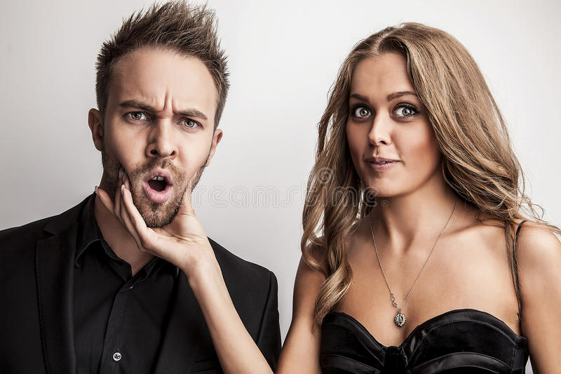 Download Portrait Of Young Attractive Couple Posing At Studio Dressed In Black Fashionable Clothes. Stock Photo - Image: 34794036