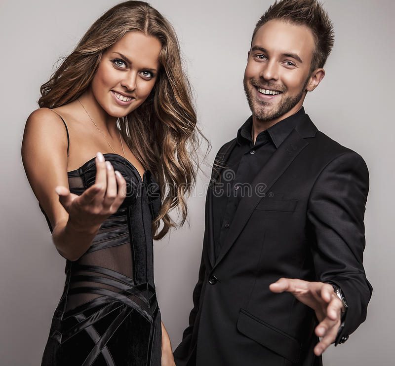 Download Portrait Of Young Attractive Couple Posing At Studio Dressed In Black Fashionable Clothes. Stock Photo - Image: 34794586
