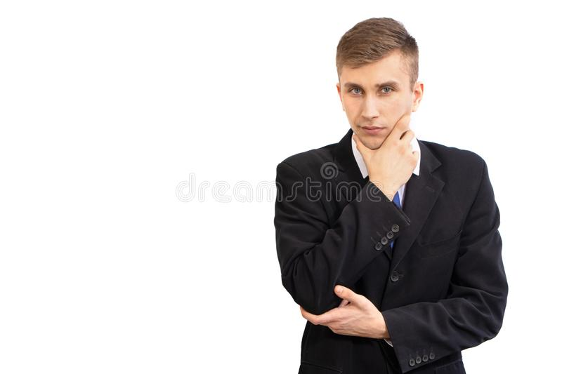 Portrait of young attractive doubting business man in a dark suit and a bright blue tie, isolated on white royalty free stock images
