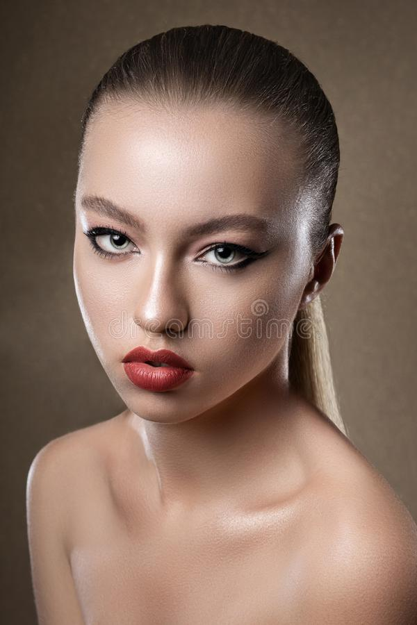 Portrait of young attractive girl model. Bright evening makeup. Perfect skin. Atelier. Woman royalty free stock images