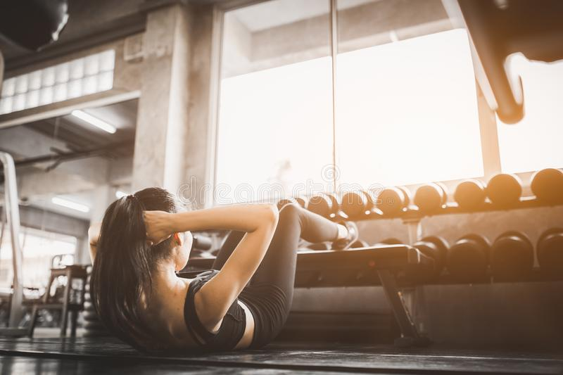 Portrait young attractive healthy woman body curve fitness doing sit up exercises workout with ball in gym. People beauty perfect royalty free stock photography