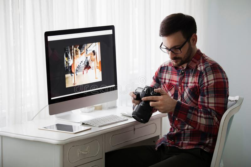 Portrait of young attractive man doing design work royalty free stock image