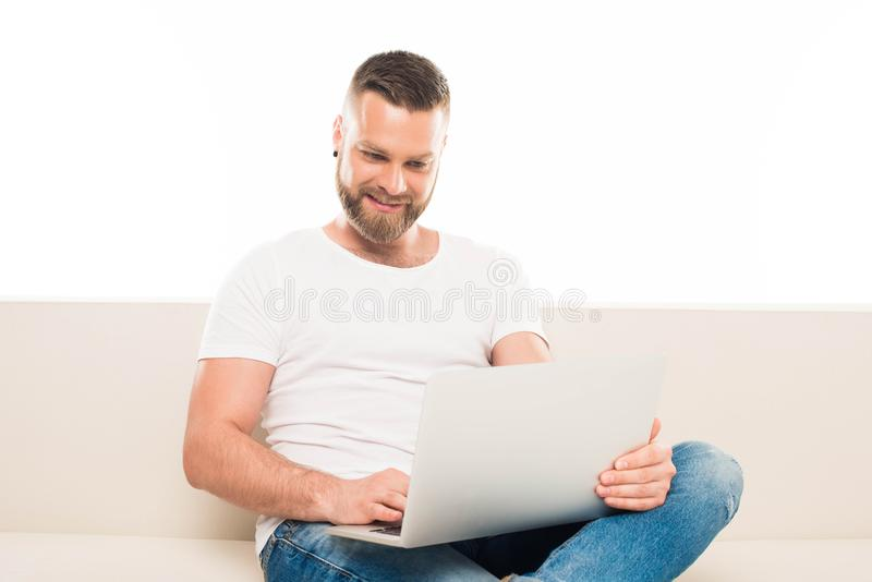 portrait of young attractive man using laptop, stock photography