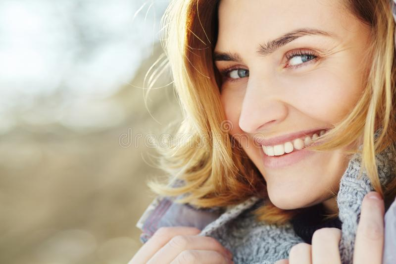 Portrait of young attractive smiling woman. beautiful female face closeup. royalty free stock photo