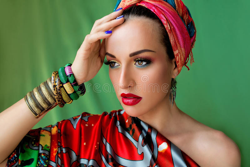 Portrait of young attractive woman in african style stock image
