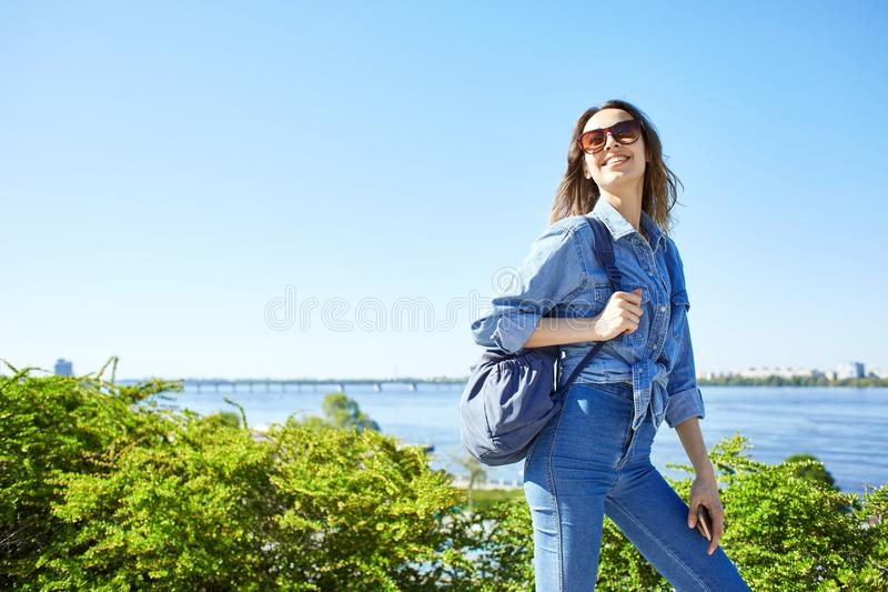 Portrait of a young attractive woman on the blue sky background stock images