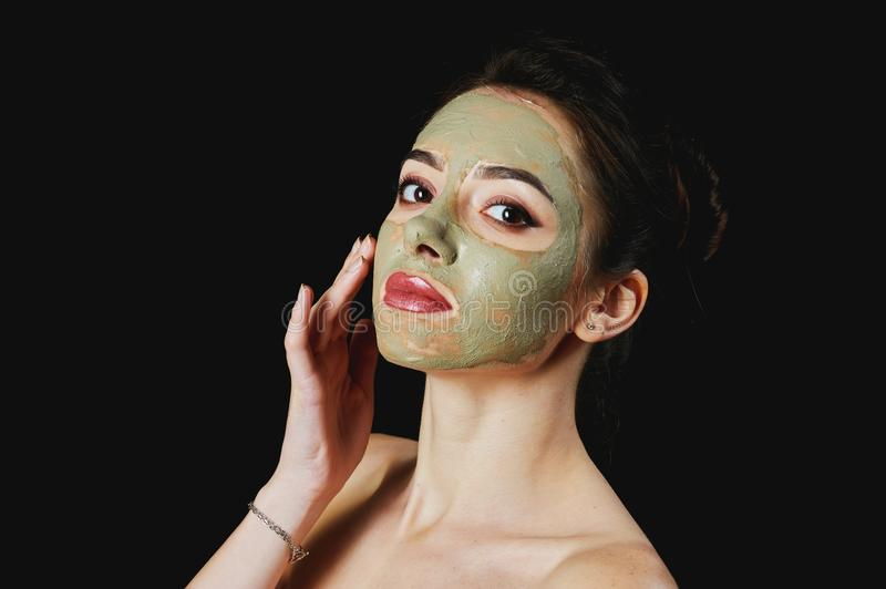Portrait of a young attractive woman in a cosmetic mask . stock photo