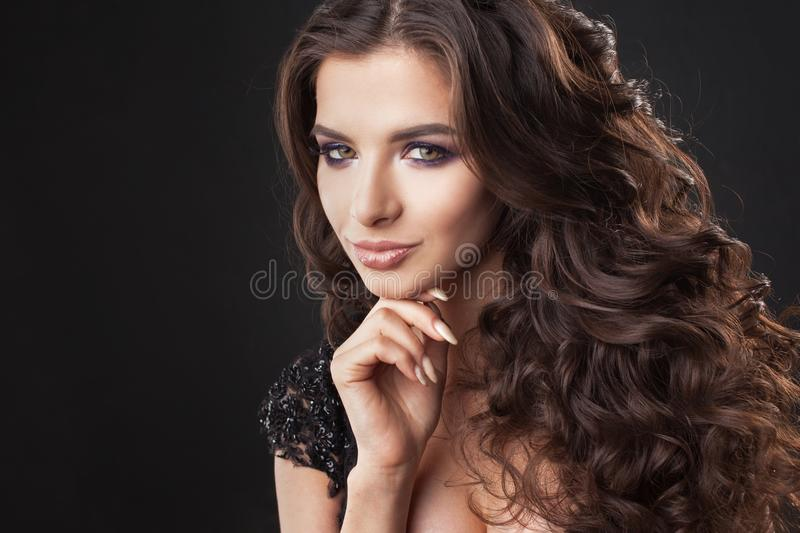 Portrait of a young attractive woman with gorgeous curly hair. Attractive brunette royalty free stock photo