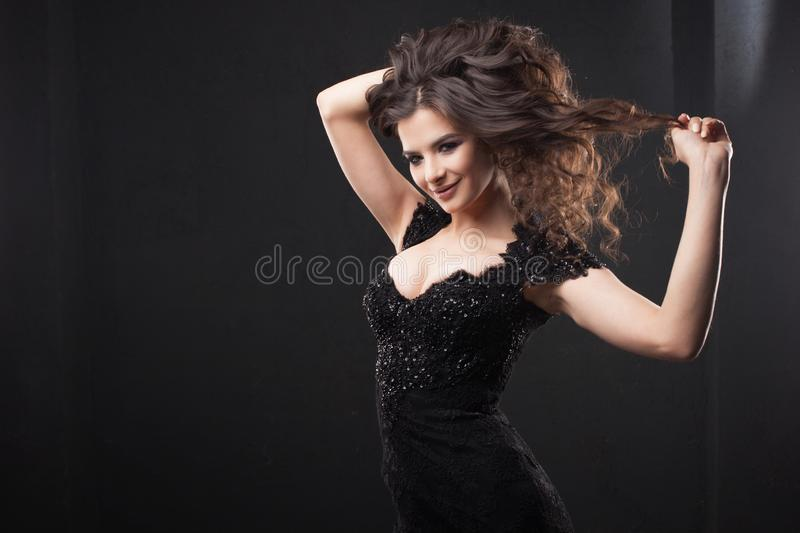 Portrait of a young attractive woman with gorgeous curly hair. Attractive brunette. royalty free stock images