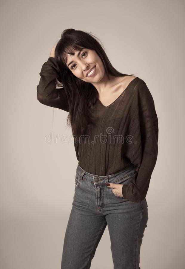 Portrait of young attractive woman with happy and smiling face. Human expressions and emotions royalty free stock photo
