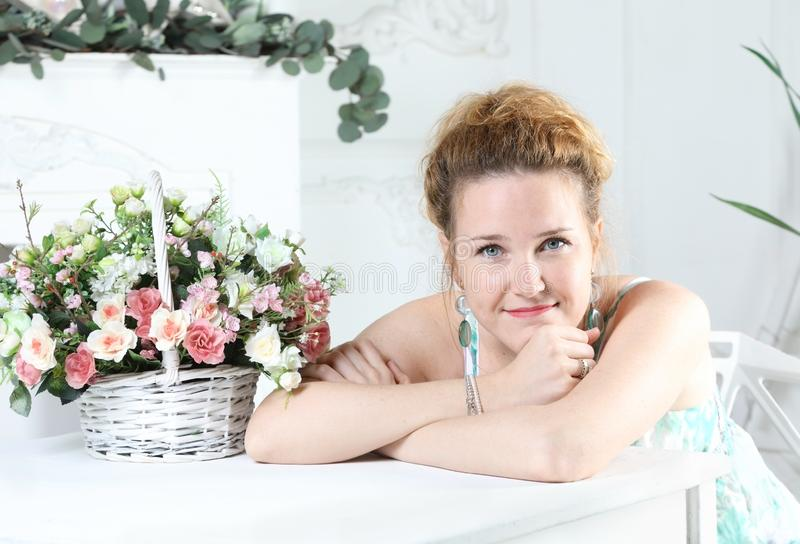 Portrait of a young attractive woman sitting at a table stock images