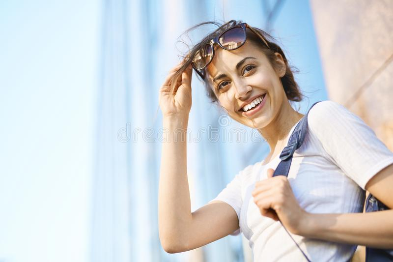 Portrait of a young attractive woman walking city at sunny day stock image