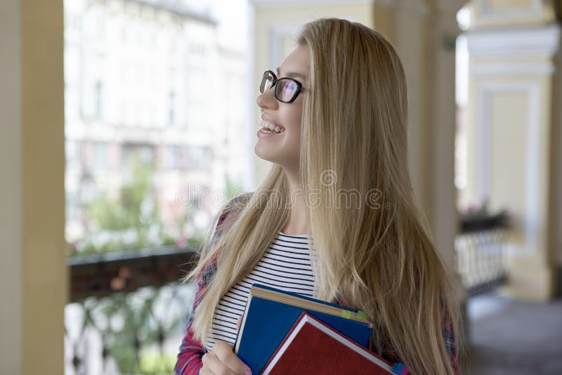 Portrait of young attractive women girl student in glasses with stock photo
