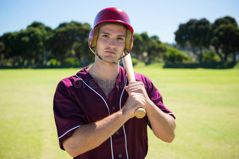 Portrait of young baseball player holding bat stock photography
