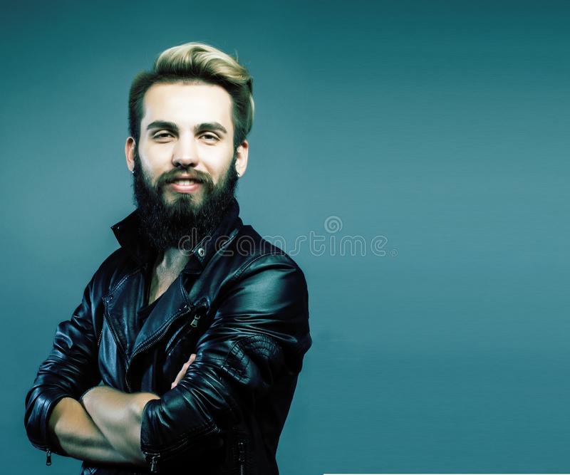 Portrait of young bearded hipster guy smiling on gray background stock images