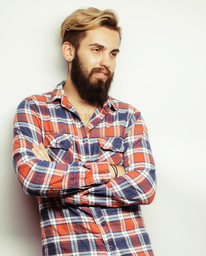 Portrait of young bearded hipster guy smiling on white background close up, brutal man. Portrait of young bearded hipster guy smiling on white background close royalty free stock photos