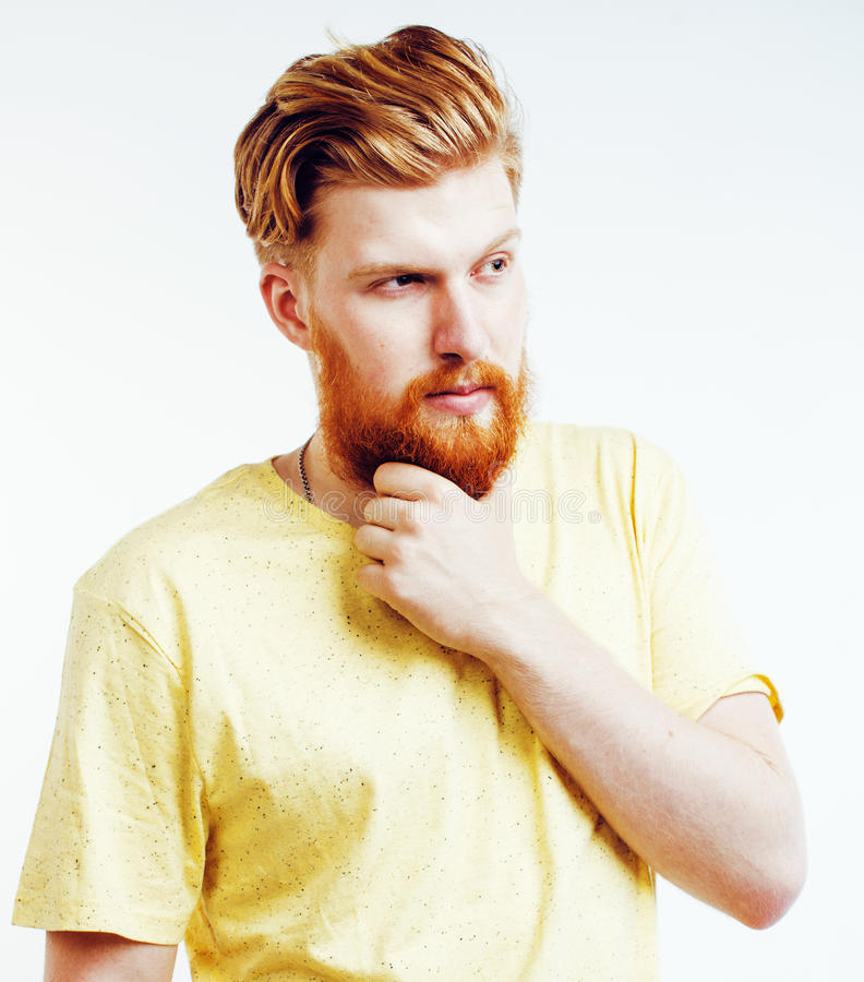Portrait of young bearded hipster guy smiling on white background close up isolated, lifestyle real modern people. Portrait of young bearded red head hipster guy royalty free stock image